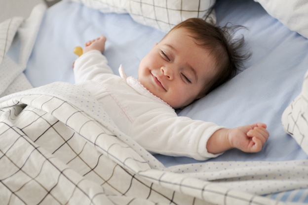 smiling-baby-lying-bed_1139-14