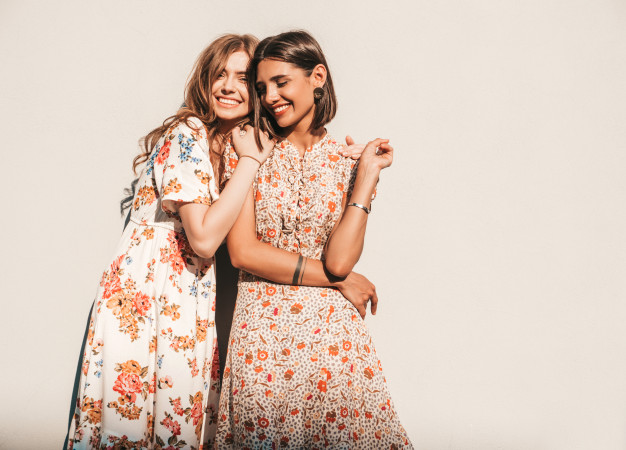 two-young-beautiful-smiling-hipster-girls-trendy-summer-sundresses_158538-16607